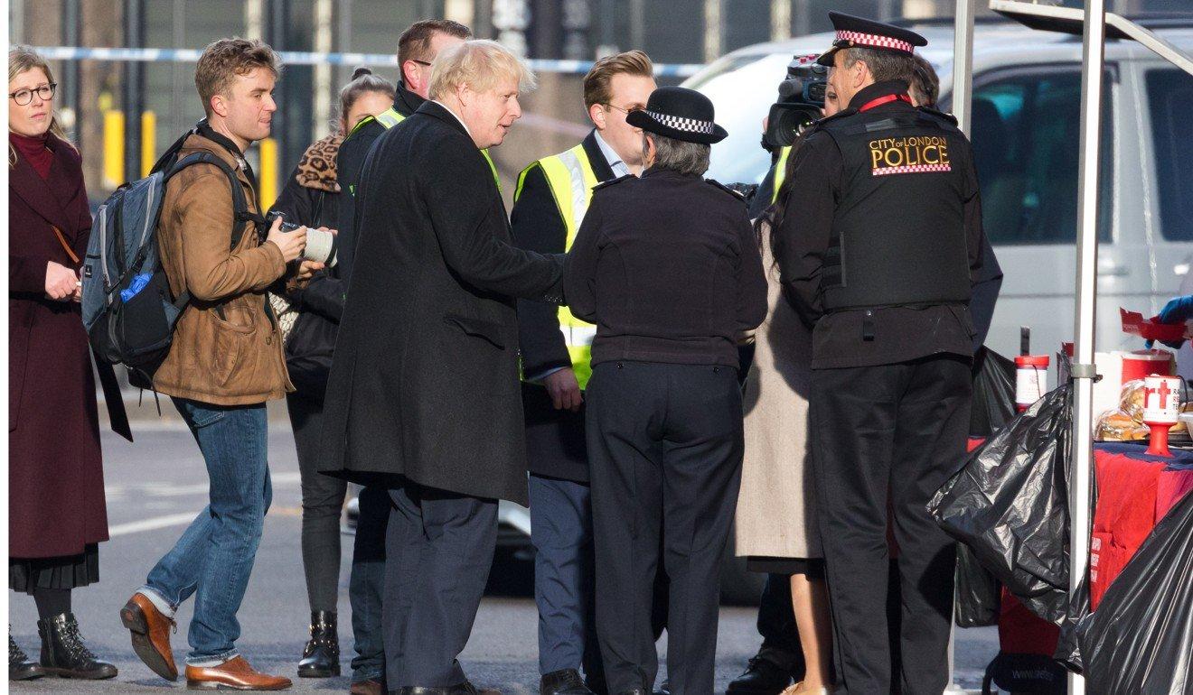 British Prime Minister Boris Johnson visits the crime scene near London Bridge in London. Photo: EPA-EFE