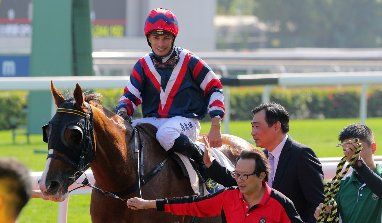 Silvestre de Sousa with Michael Chang after the win of Mister Monte at Sha Tin.