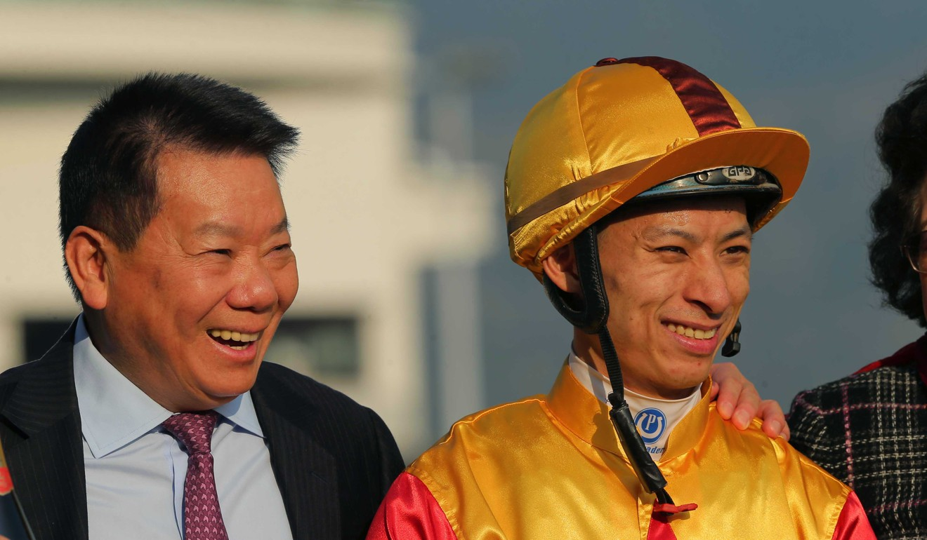 Trainer Manfred Man (left) and jockey Matthew Chadwick celebrate Big Time Baby's win.
