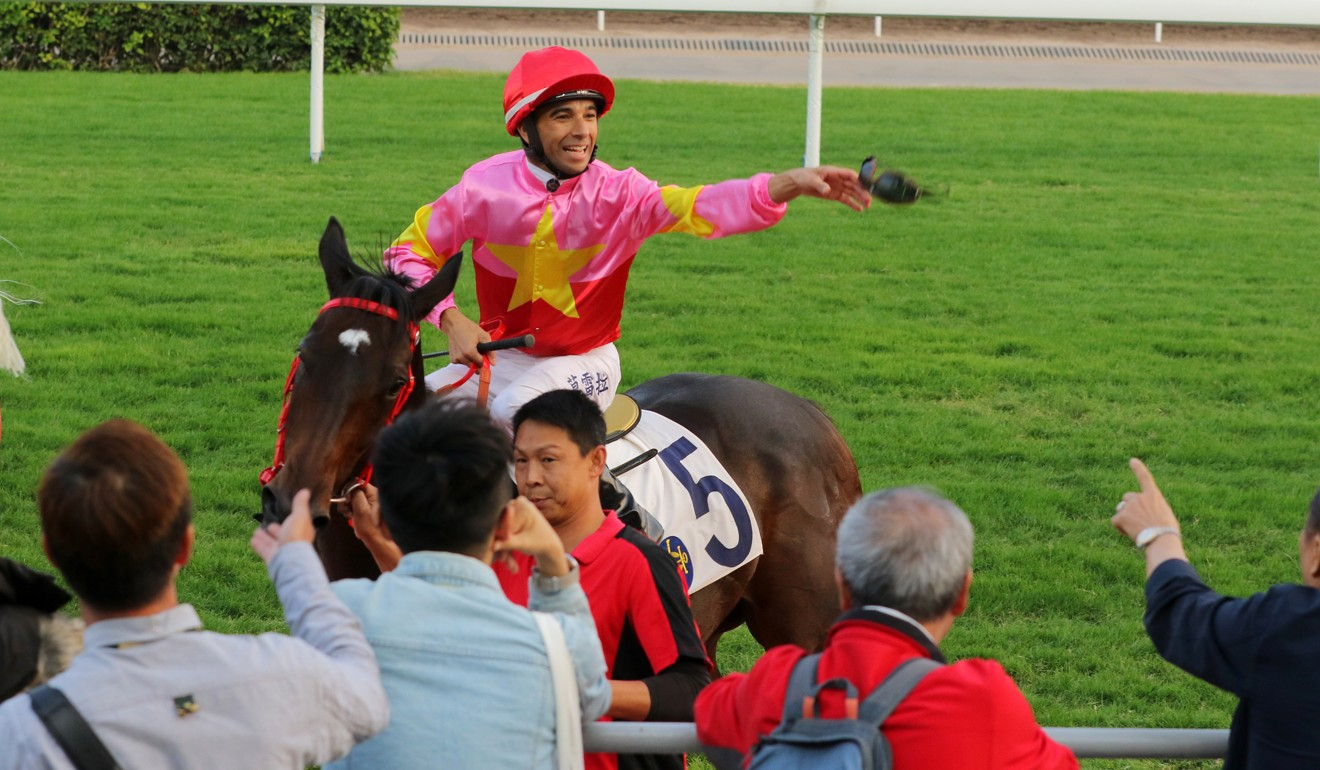 Joao Moreira throws his goggles into the crowd after winning on Follow Me.