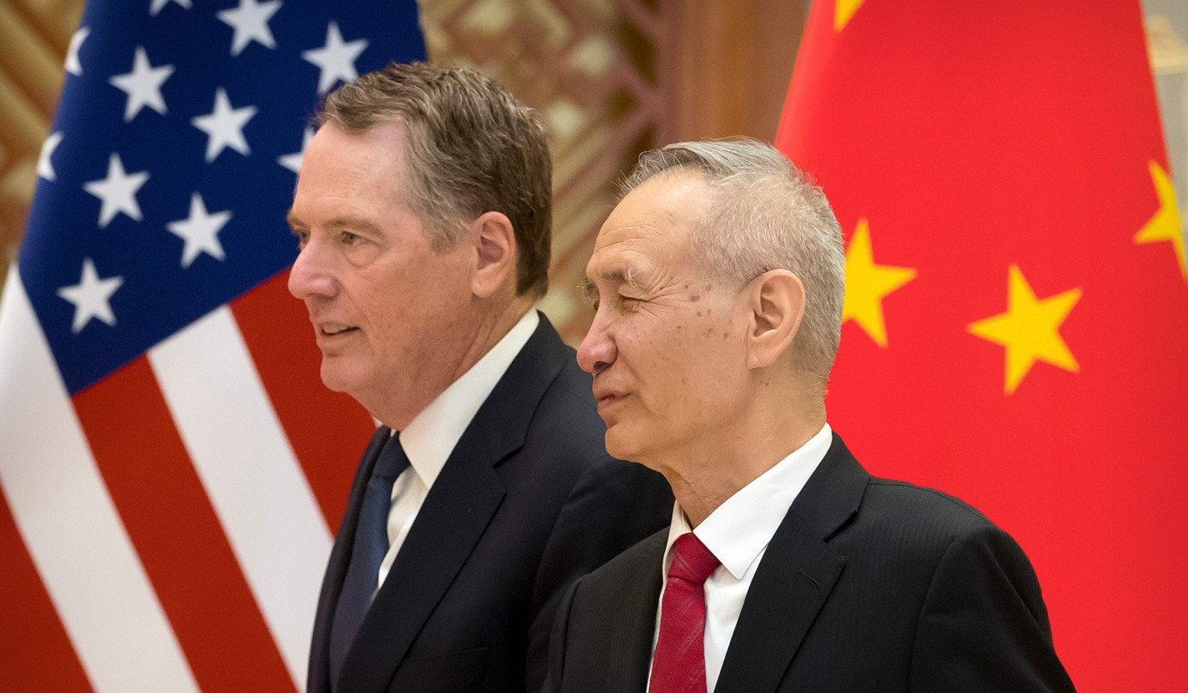 US Trade Representative Robert Lighthizer talks to Chinese Vice-Premier Liu He while they line up for a group photo at the Diaoyutai State Guesthouse in Beijing on February 15. The rapid surge in global debt has largely been driven by the US and China. Photo: AFP