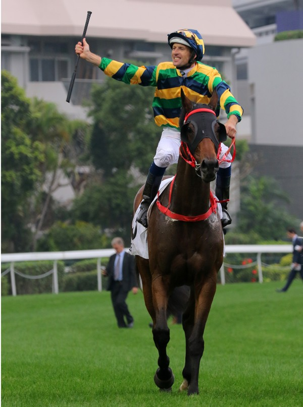 Hugh Bowman celebrates Furore's Hong Kong Derby win.