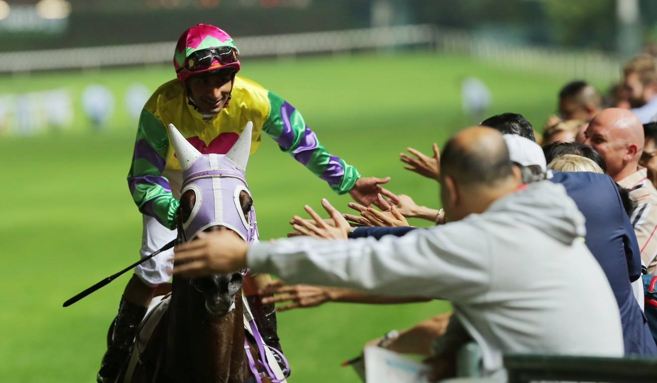 Karis Teetan celebrates a winner with fans at Happy Valley last month.