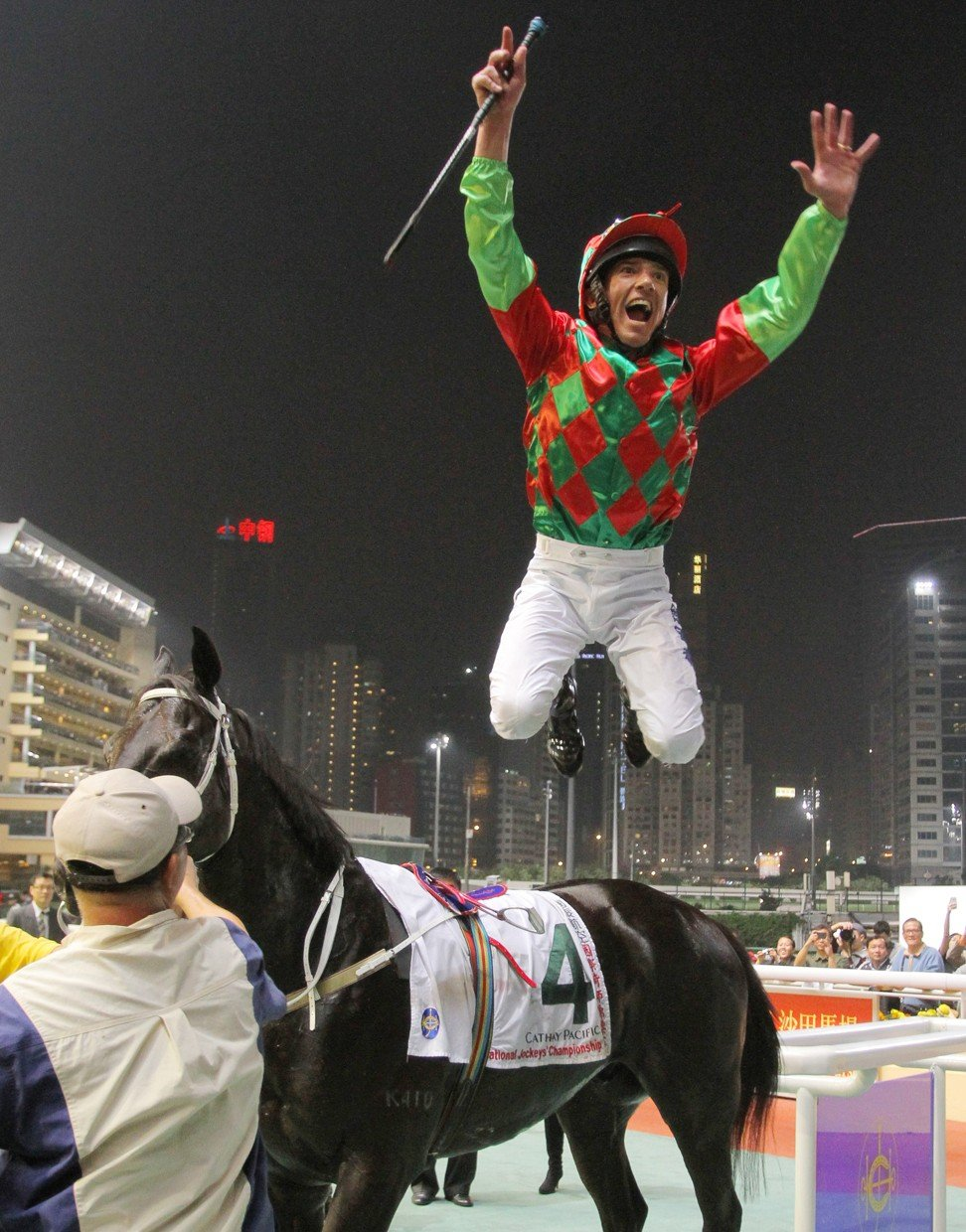 Frankie Dettori performs the flying dismount after winning his third IJC title in 2011.