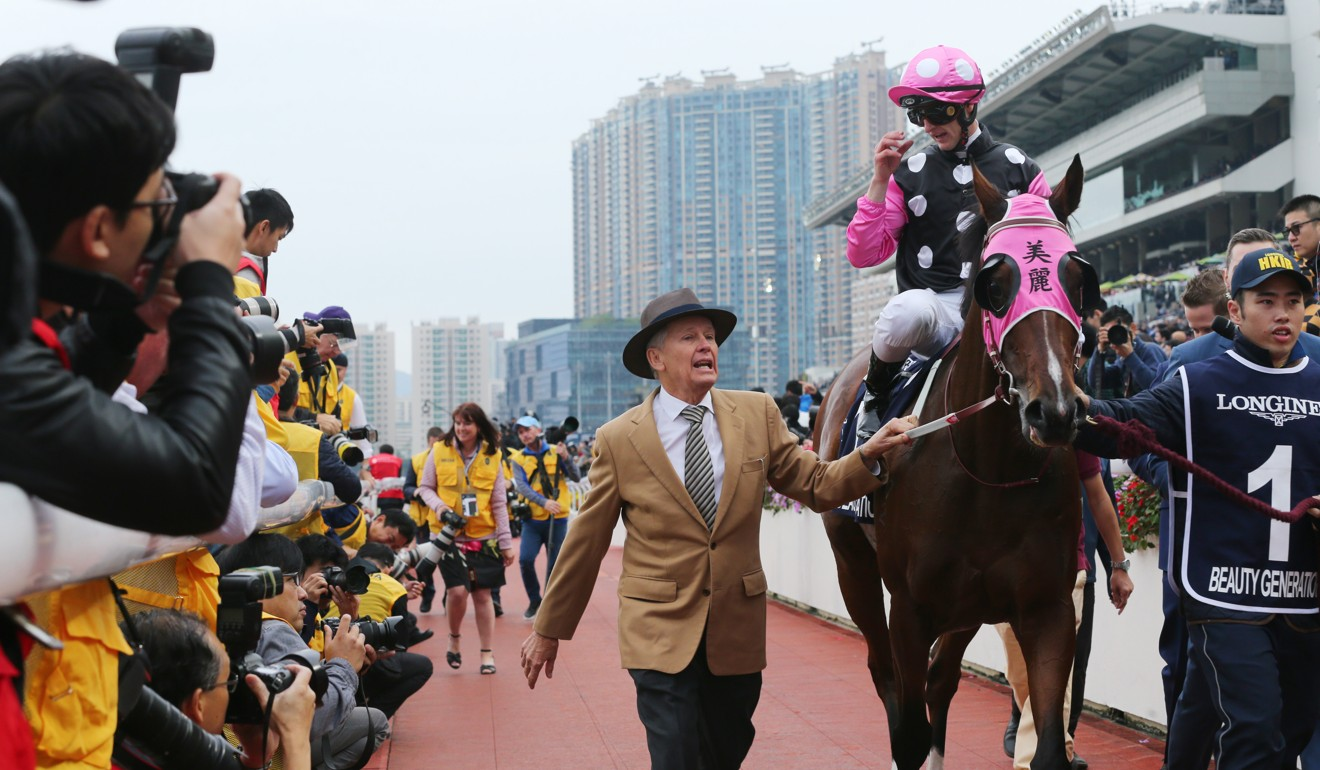 Trainer John Moore leads Beauty Generation after his win in the 2018 Hong Kong Mile.