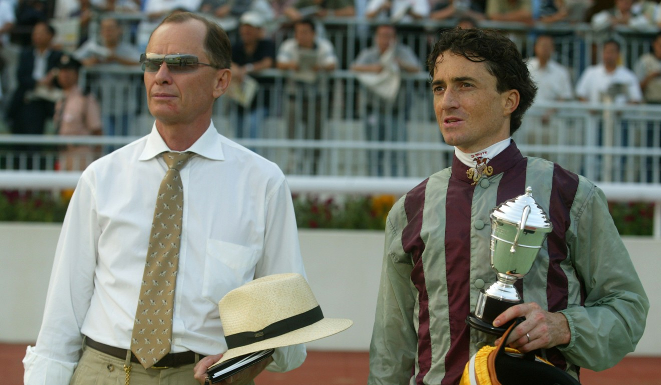 Trainer John Moore and jockey-turned-handler Douglas Whyte at Sha Tin in 2004.