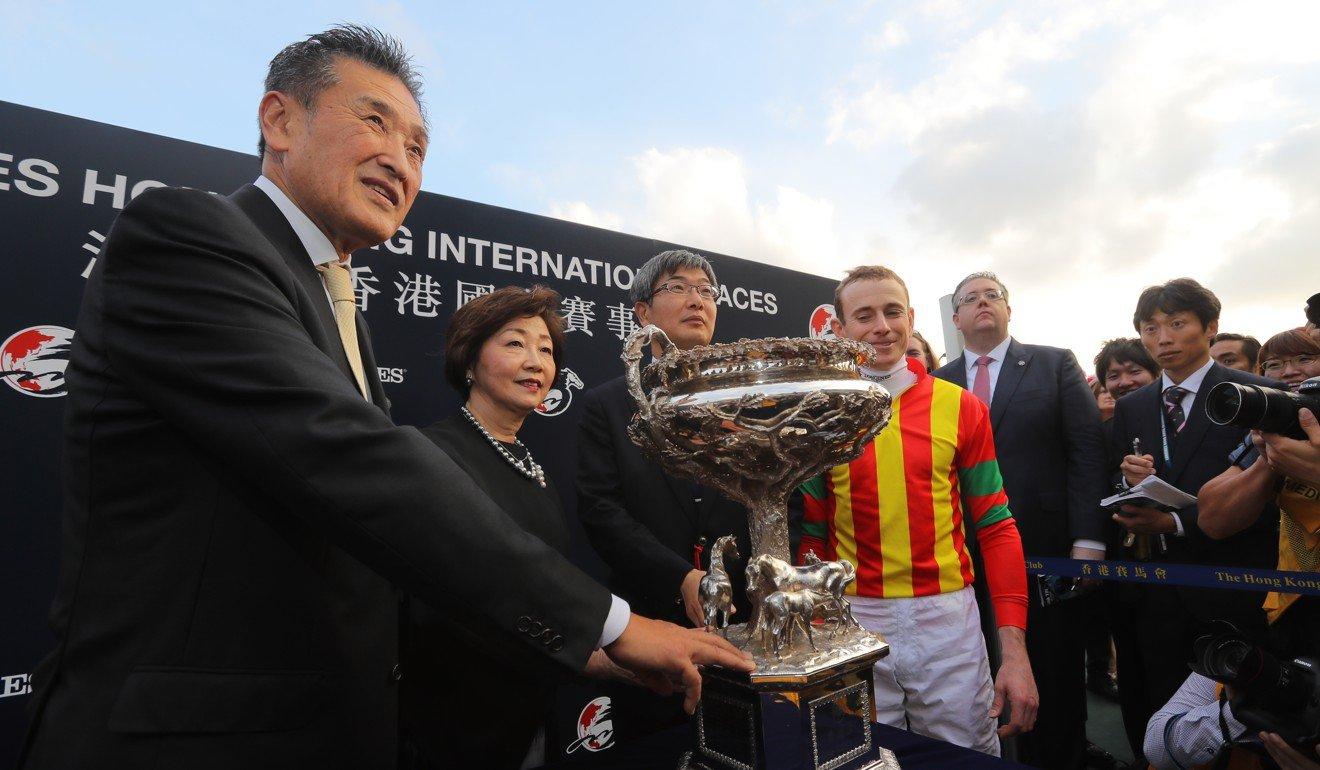 Katsumo Yoshida (left) celebrates Maurice's Hong Kong Cup victory.