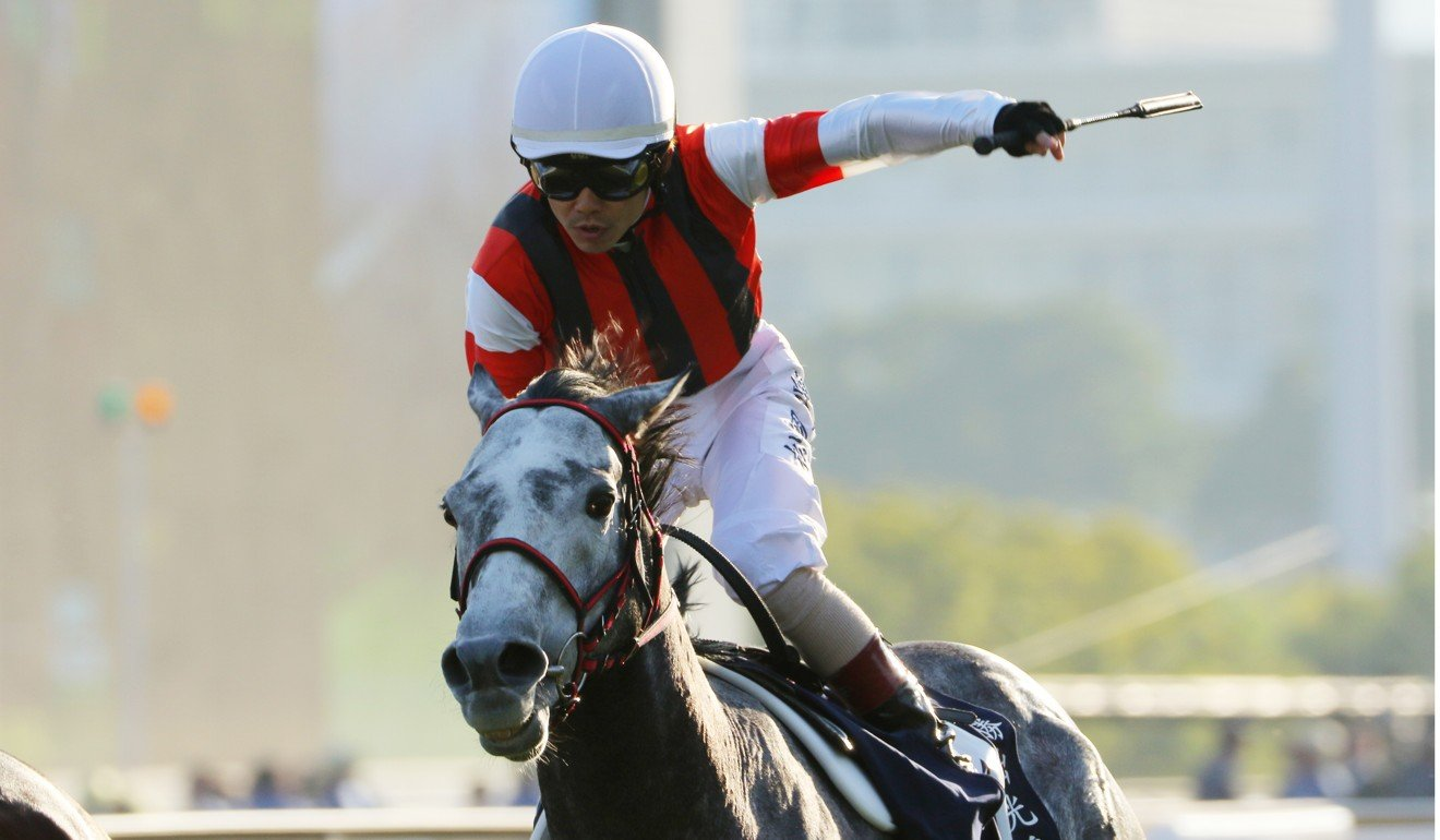 Masami Matsuoka salutes as Win Bright collects the Hong Kong Cup.