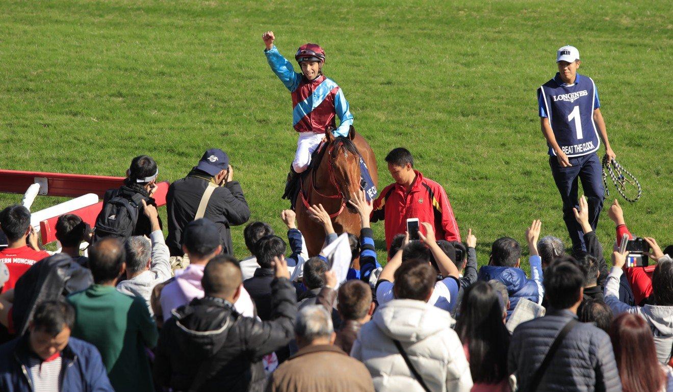 Joao Moreira salutes the crowd.