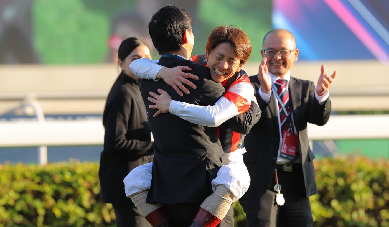 Jockey Masami Matsuoka celebrates after winning on Win Bright.