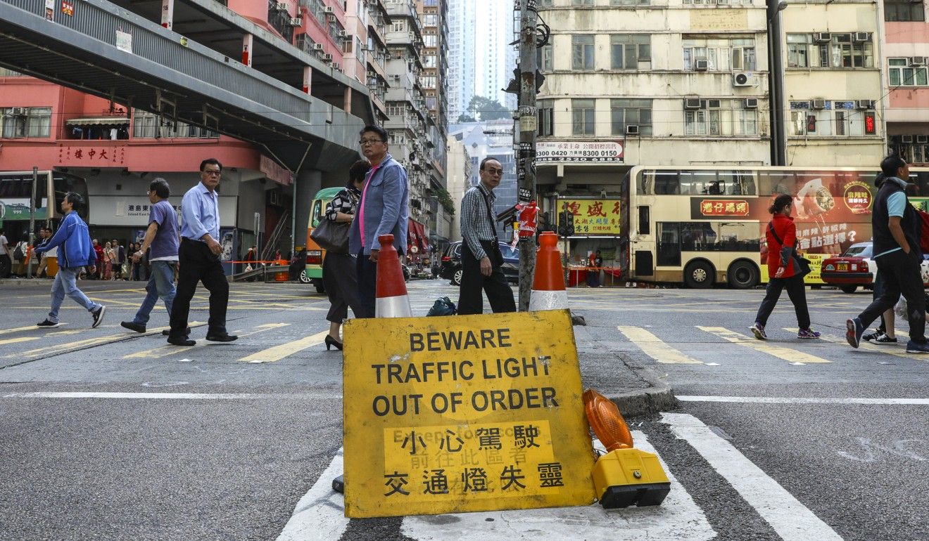 Damaged traffic lights, like these at Sai Wan Ho, are one of the many dangers faced by Hong Kong's disabled population. Photo: May Tse