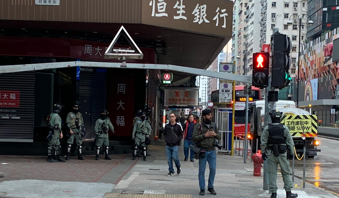 Riot police wait on a street corner in Mong Kok. Photo: Victor Ting