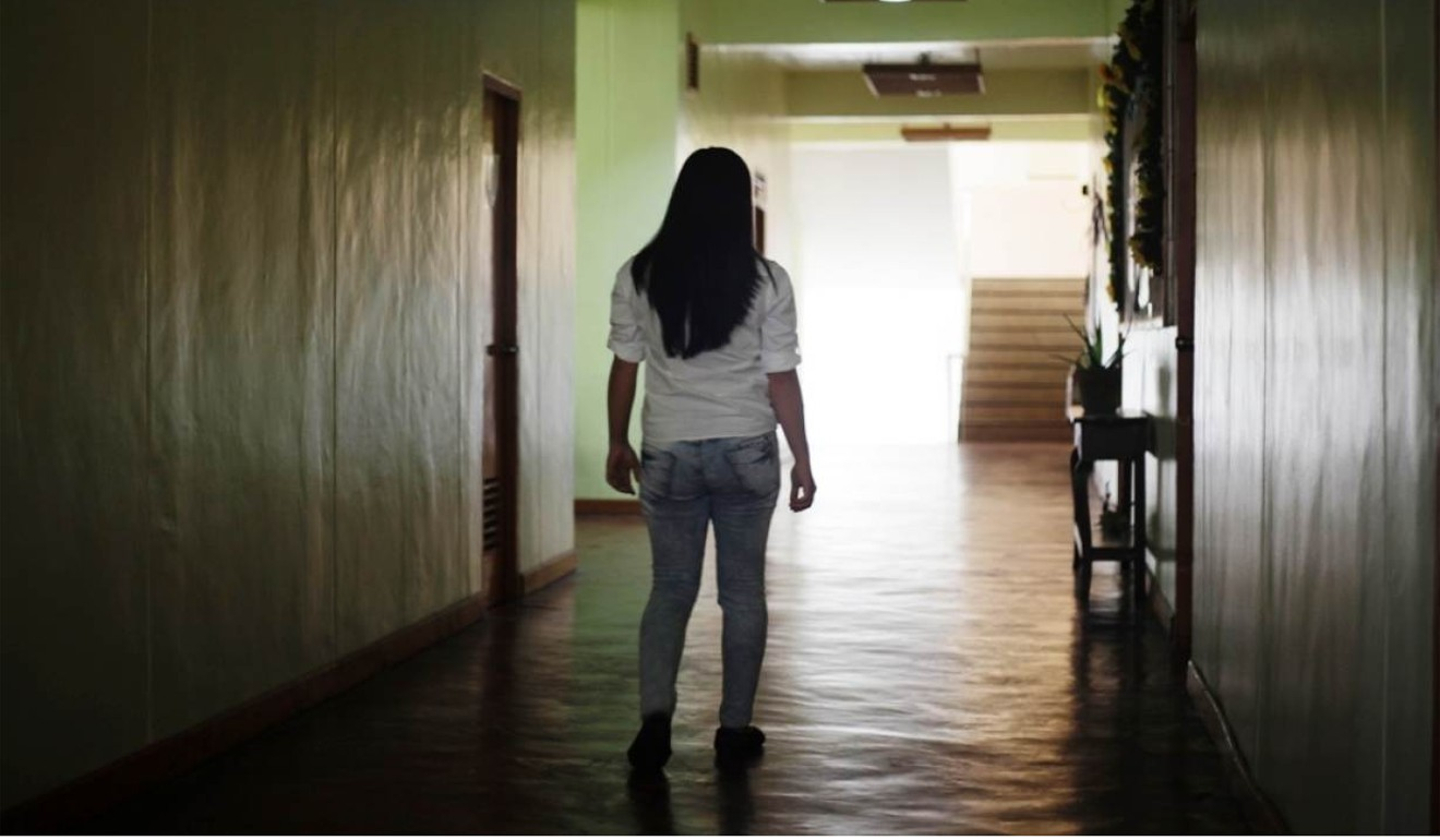 A victim of trafficking is pictured walking down a corridor in a church in Tagaytay, the Philippines. Photo: Reuters