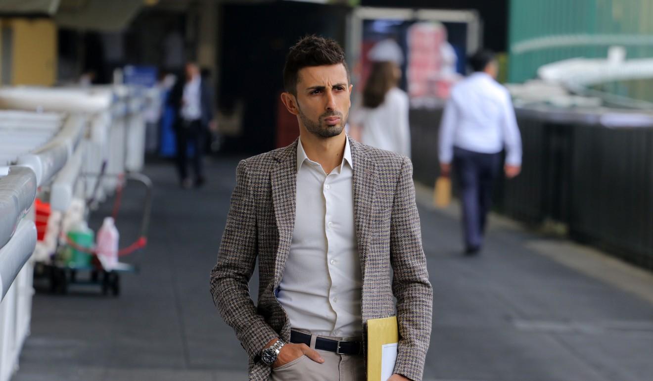 Jockey Alberto Sanna walks into his inquiry at Happy Valley last month.