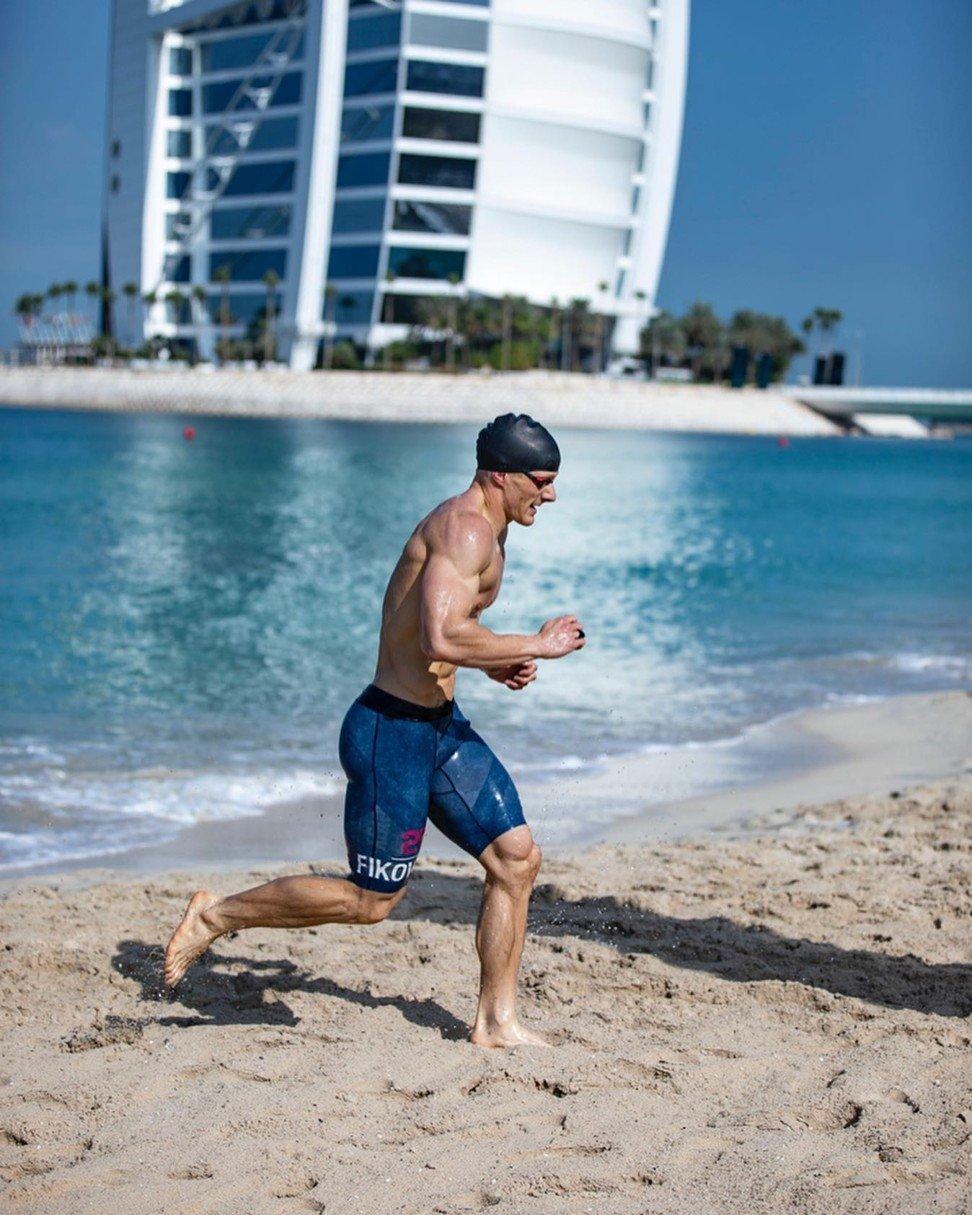 Brent Fikowski runs up the beach in front of the Burj Al Arab Jumeirah hotel. Photo: Dubai CrossFit Championship