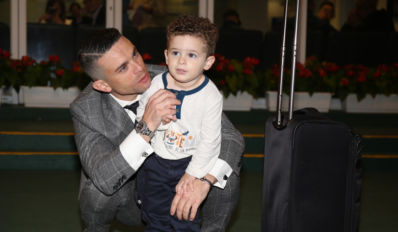 Jockey Umberto Rispoli with his son Hayden after his final ride in Hong Kong.