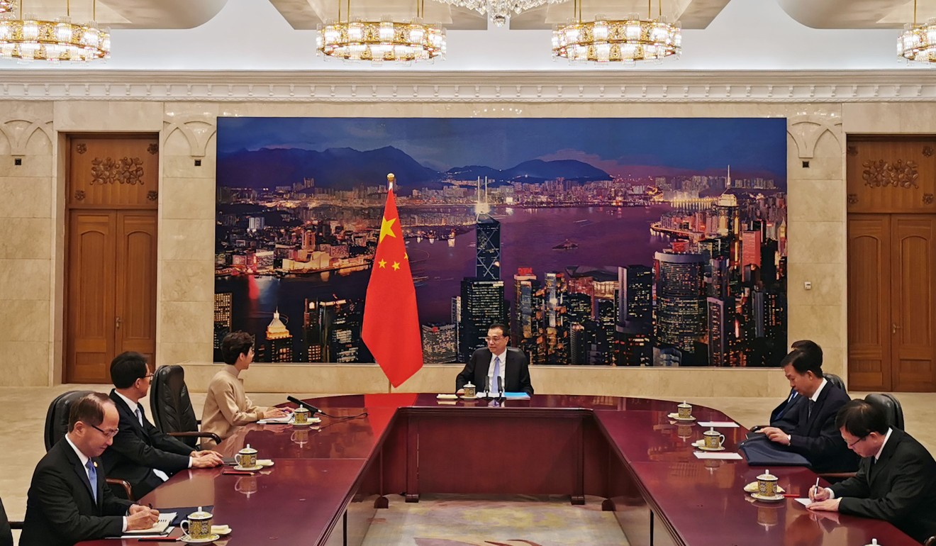 Premier Li Keqiang reminded Carrie Lam that she still had her work cut out for her. Photo: Pool