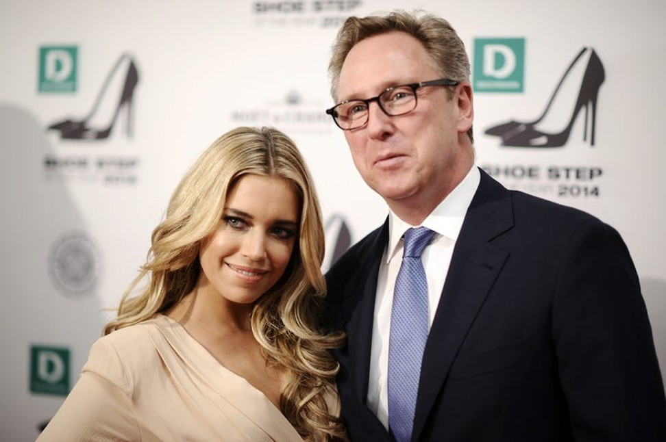 Heinrich Deichmann (phải) với người mẫu Hà Lan Sylvie Meis. Ảnh: Getty Images