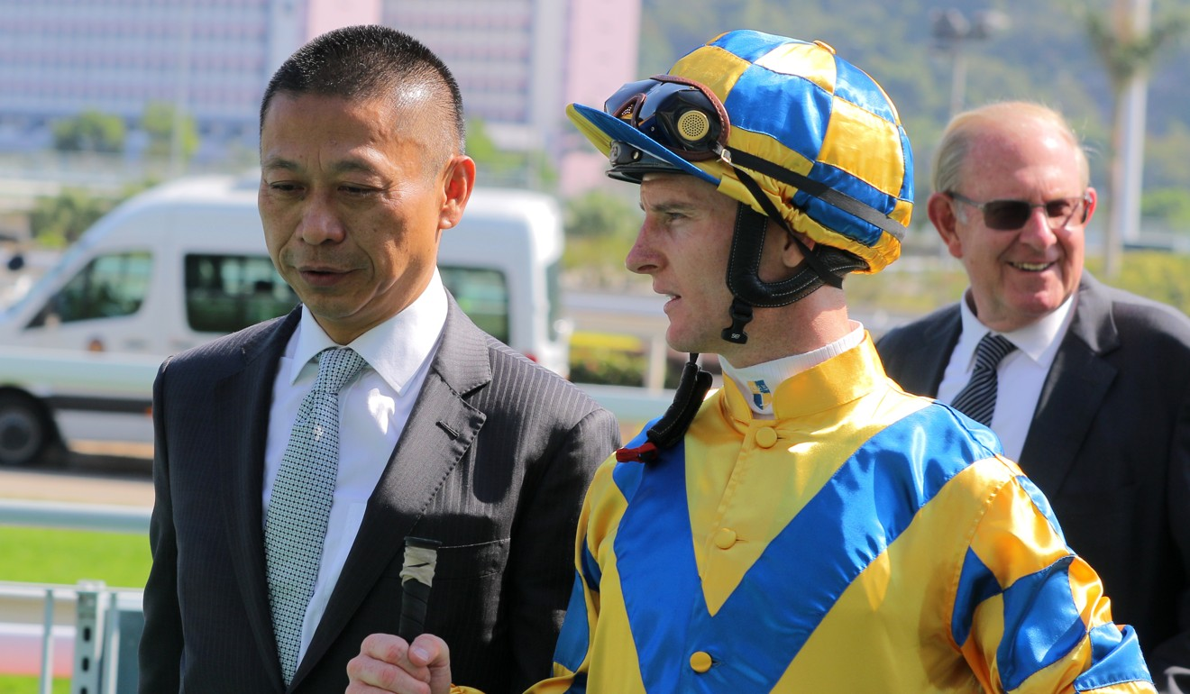 Trainer Danny Shum with jockey Zac Purton after the win of Lucky More.