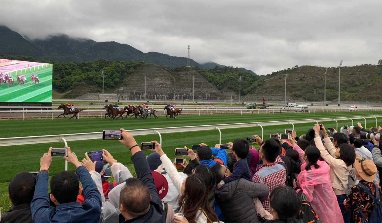 Fans capture the action at the first official meeting at Conghua.