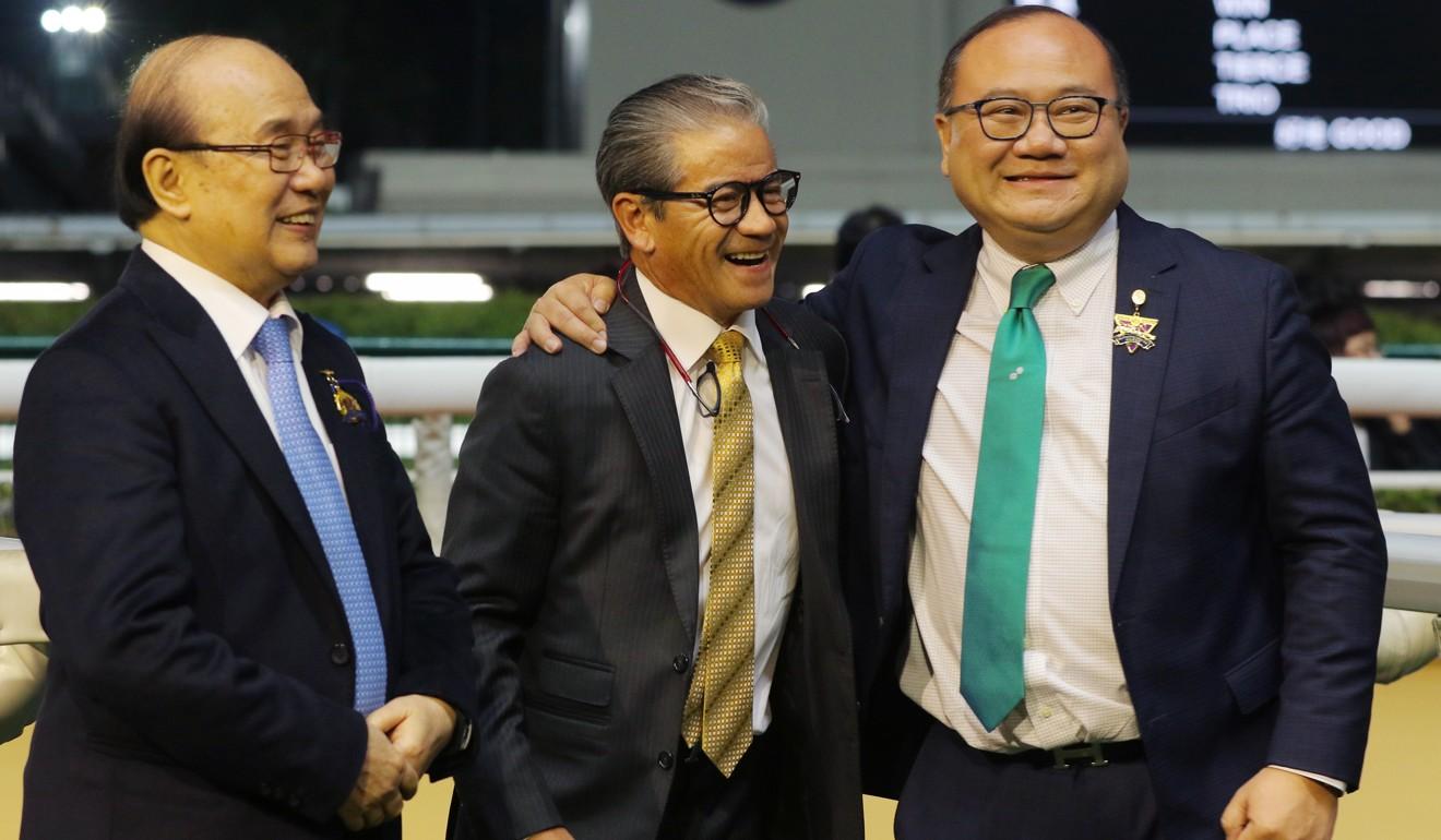 Tony Cruz (centre) celebrates Private Secretary's win with the Siu family at Happy Valley.