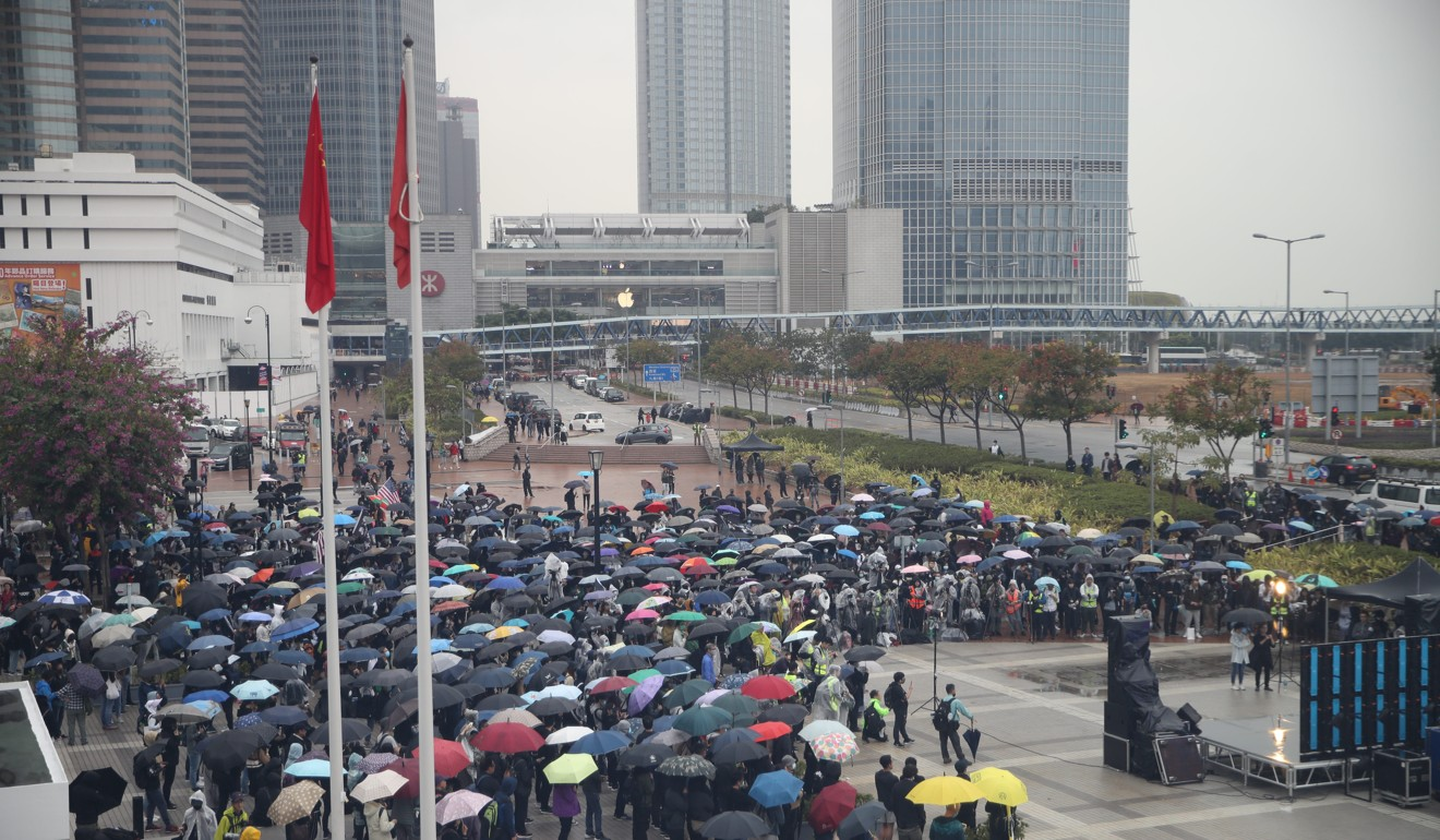 Protesters gather in the pouring rain on Sunday afternoon in Central. Photo: Winson Wong