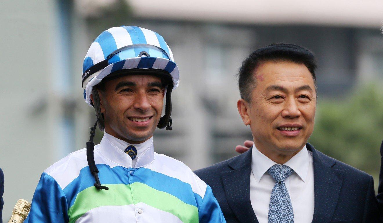 Jockey Joao Moreira and trainer Ricky Yiu celebrate Voyage Warrior's victory.