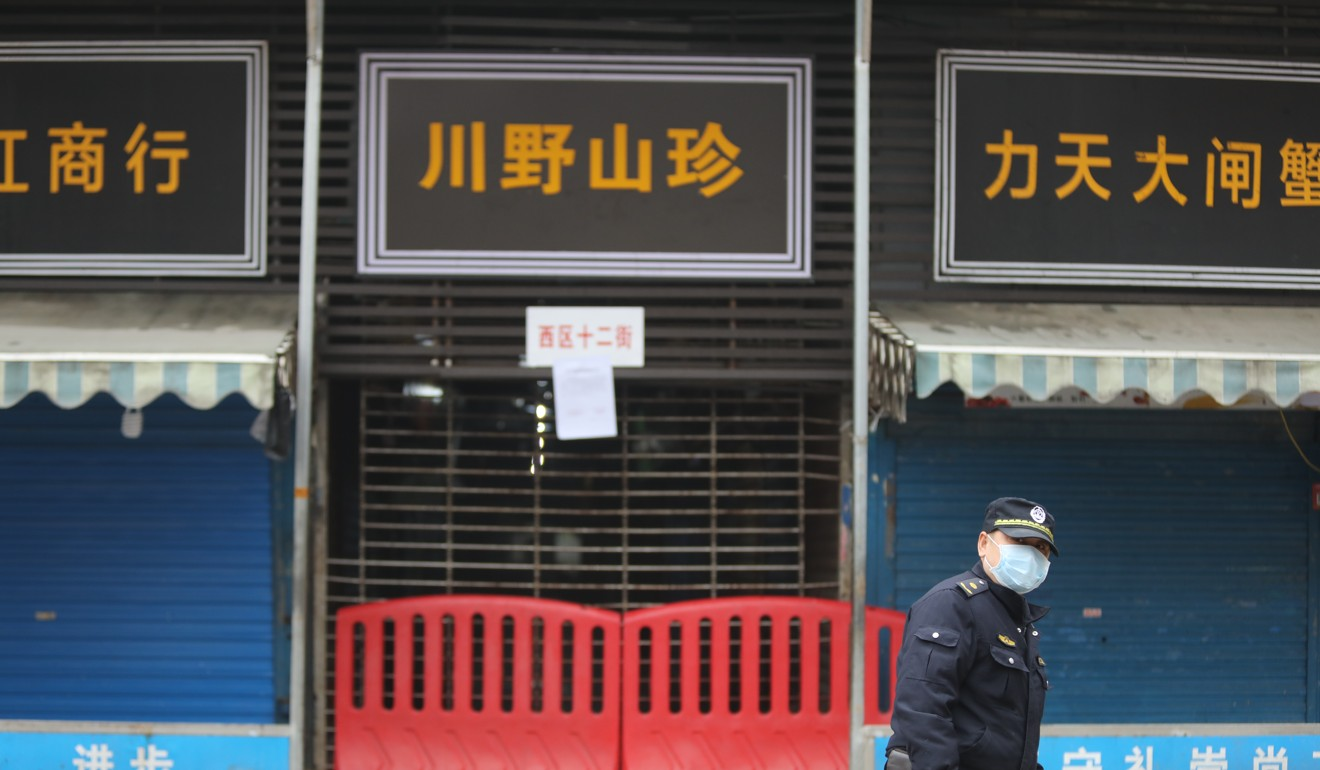 A security patrol outside the Wuhan Huanan Seafood Wholesale Market, which has been identified as the site of the outbreak. Photo: Simon Song