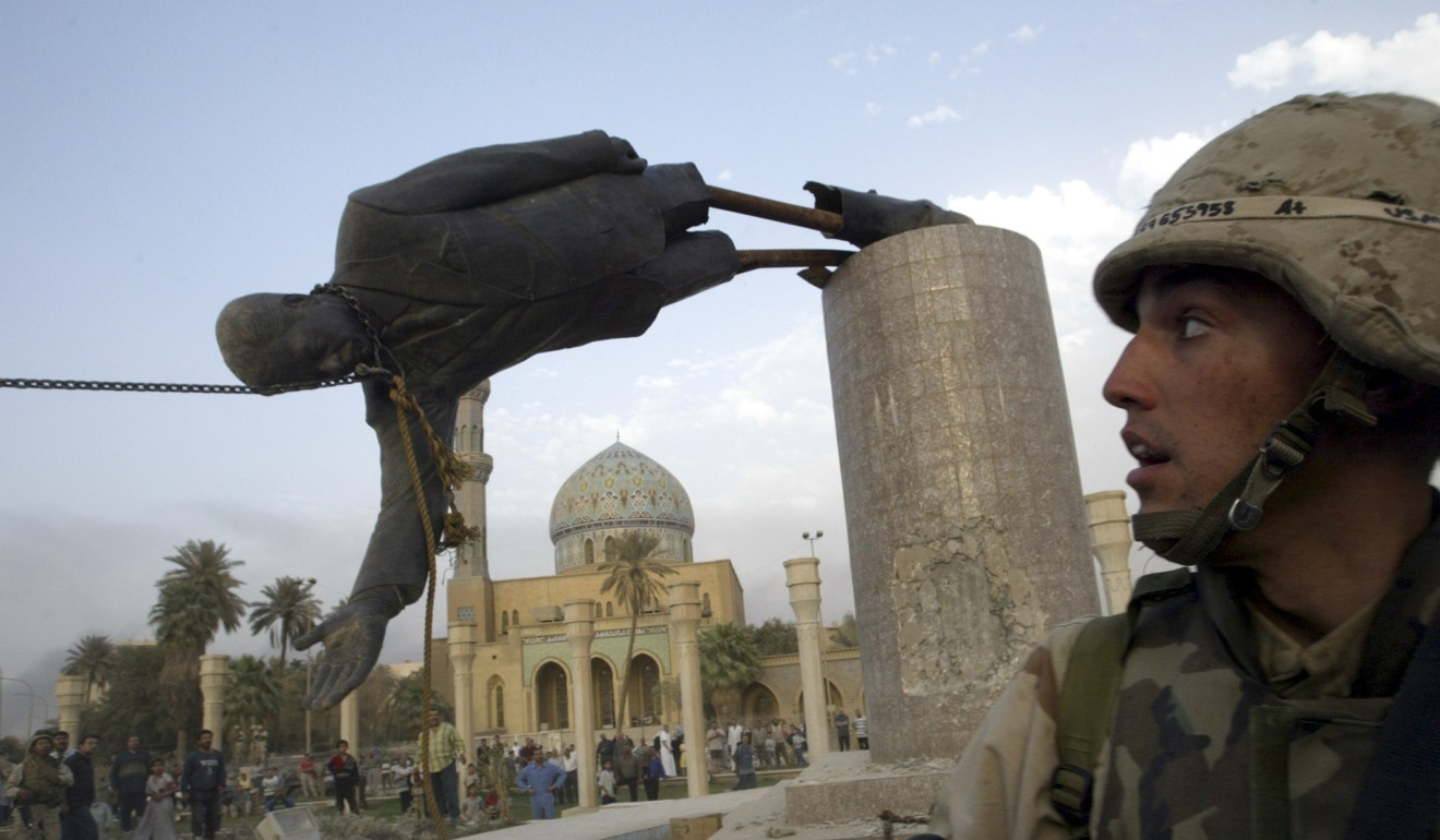 A US Marine watches as a statue of Iraq's president Saddam Hussein falls in central Baghdad on April 9, 2003. The US invasion of Iraq set off a series of events that plunged the region into conflict and can be tied to the rise of extremist groups such as Islamic State. Photo: Reuters