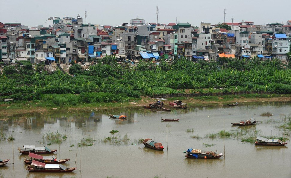 Tiny houses along the banks of the Hanoi's Red River, which runs close to its Old Quarter. Poor urban management by Vietnamese cities, including housing construction and planning, has been often criticised in official media. Photo: AFP via Getty Images