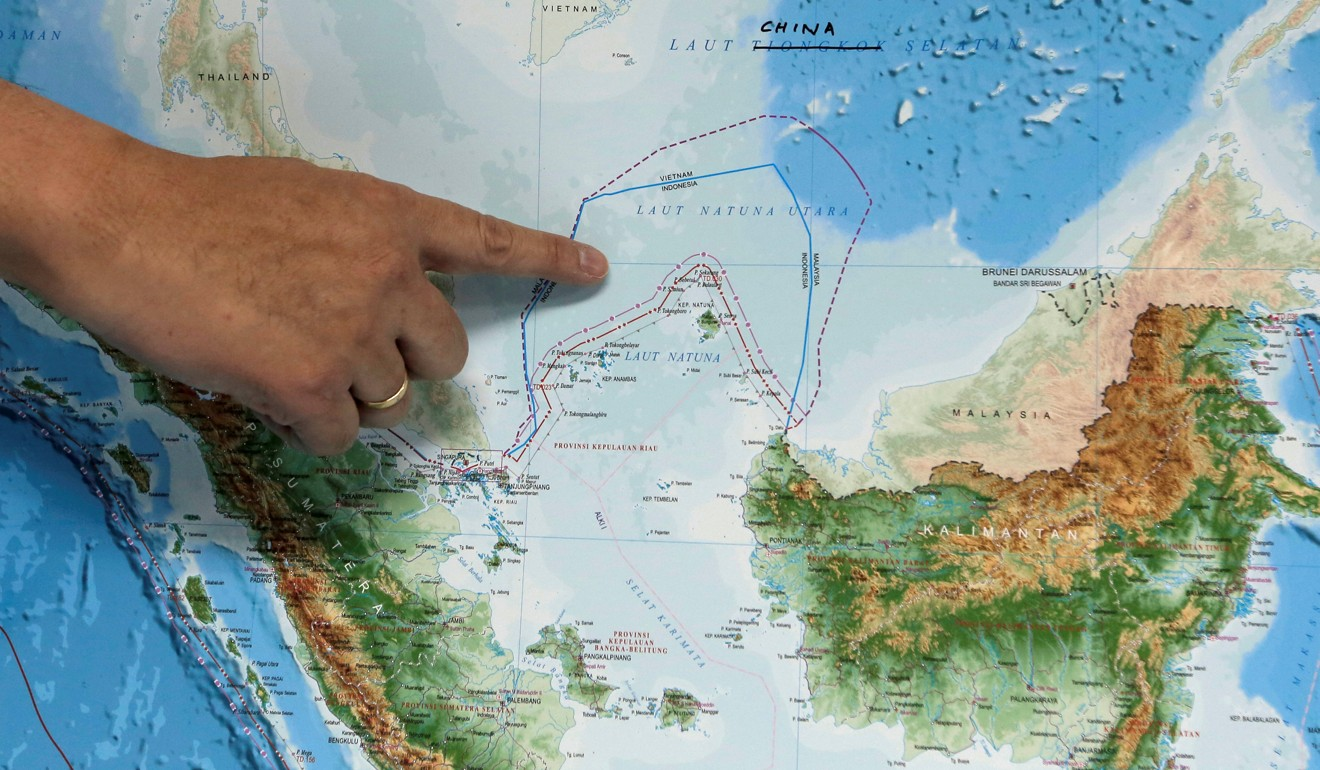 An Indonesian official indicates the location of North Natuna Sea. Photo: Reuters