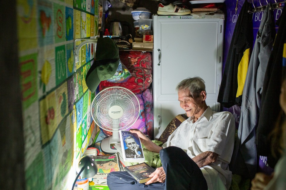 Chu Van Cao in his 2-square-metre room which he shares with his 31-year-old son. Photo: Chris Humphrey