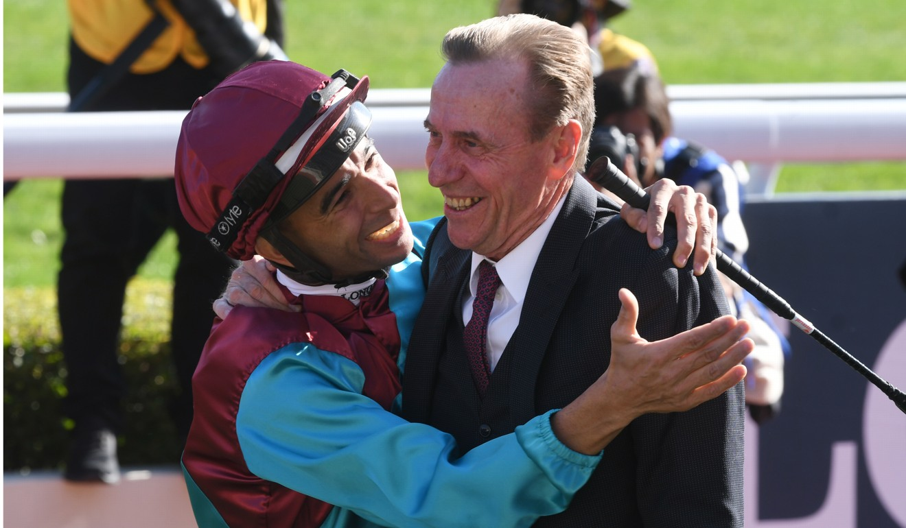 Joao Moreira gives John Size a hug after winning the Group One Hong Kong Sprint with Beat The Clock.