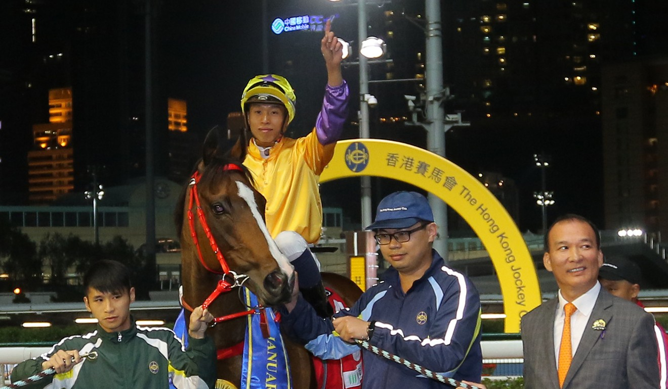 Jockey Vincent Ho celebrates Doctor Geoff's victory on Wednesday night with owner Huang Kai-wen (right).