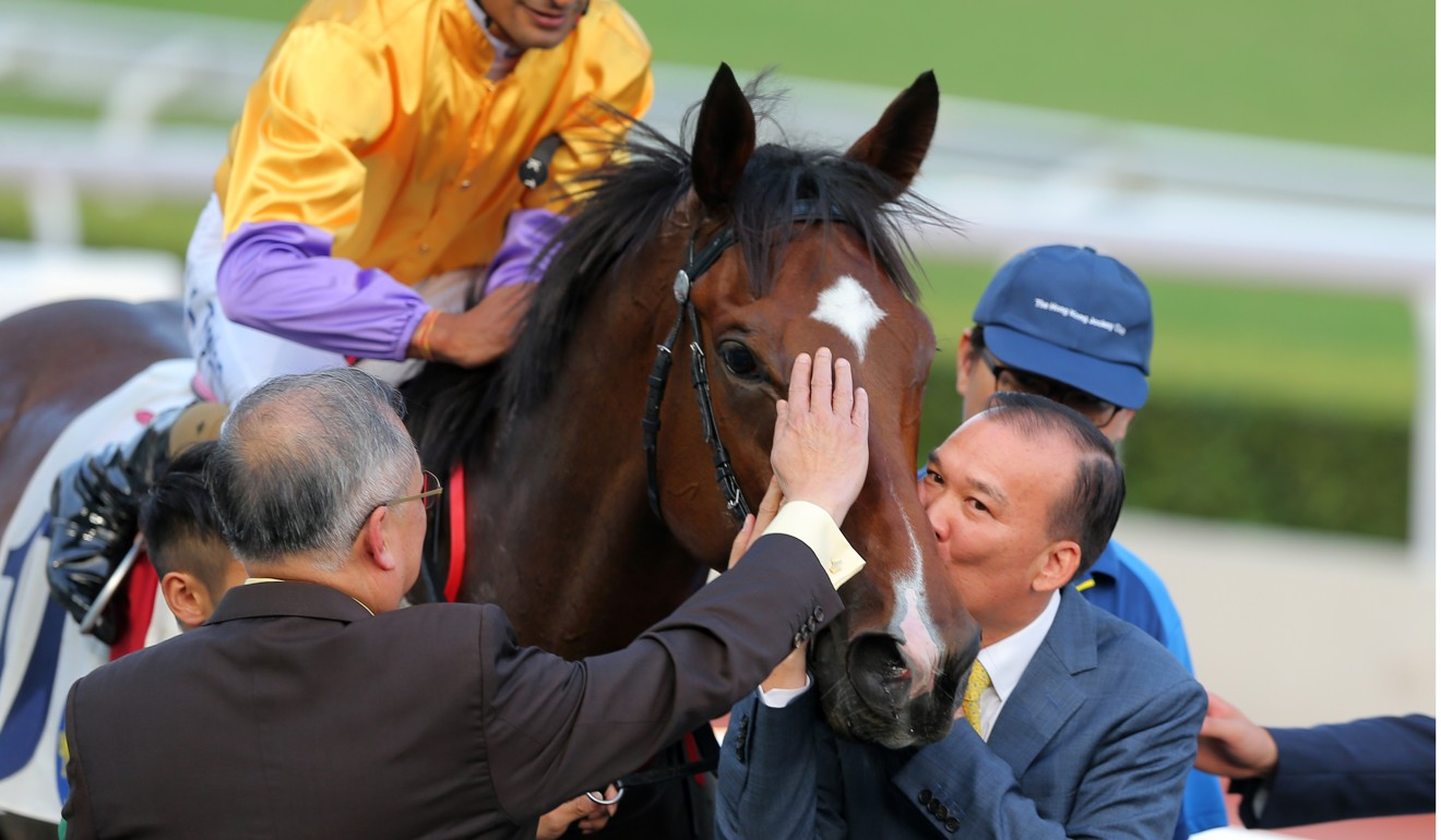 Owner Huang Kai-wen gives More Than This a kiss after a win earlier this season.