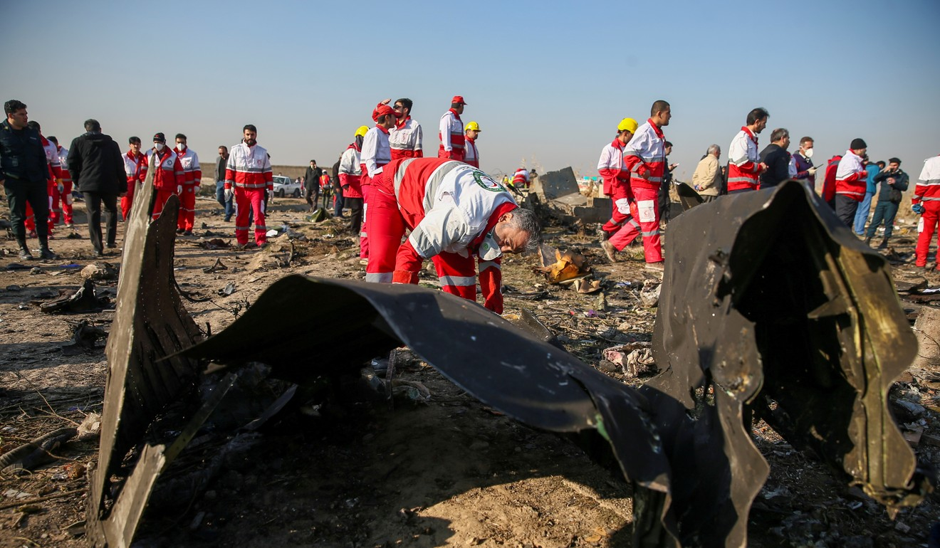 Workers at the site of the crash in Tehran on January 8, 2020. Photo: West Asia News Agency