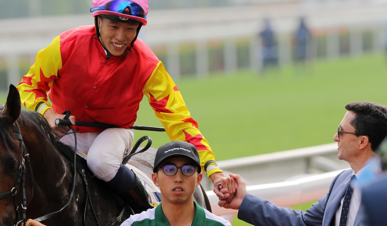 Trainer Douglas Whyte (right) shakes jockey Vincent Ho's hand after Farhh Above's win on Saturday.