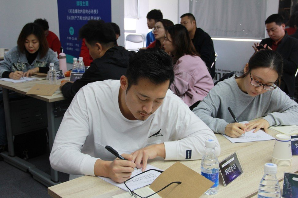 Actor Awangduoji (in white) and other participants of a class on how to get rich on Douyin. Photo: Guyizouhong