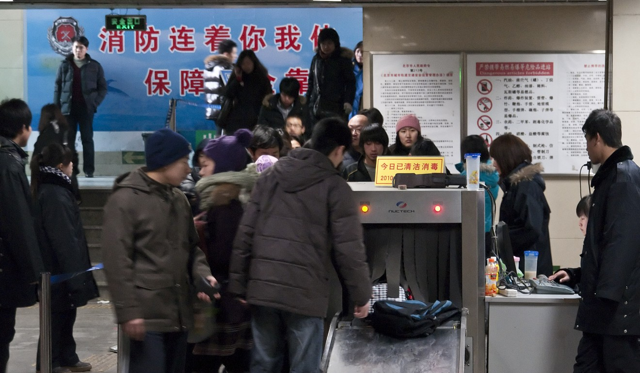 Passengers go through security checks at the Dongzhimen subway station in Beijing. Photo: AFP