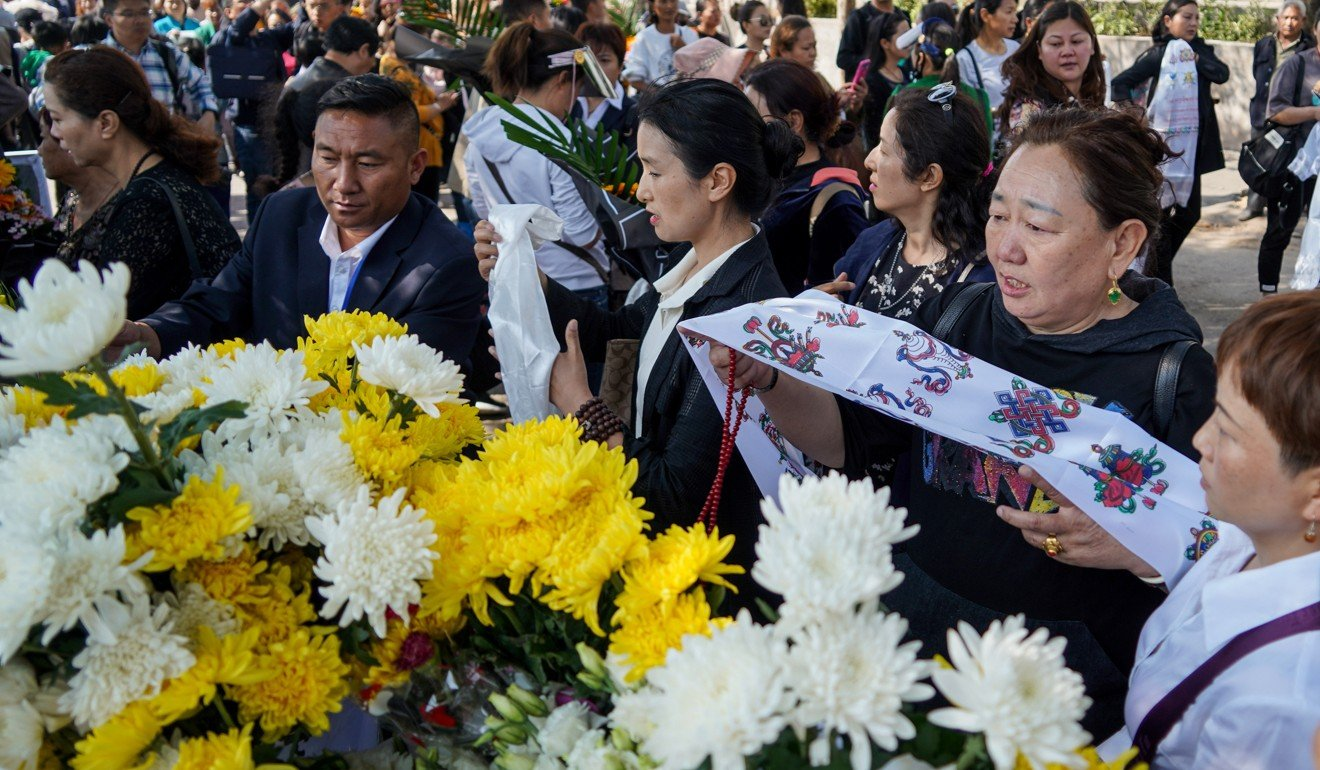 A mourning ceremony for the 30 firefighters killed in Sichuan last year. Photo: Xinhua