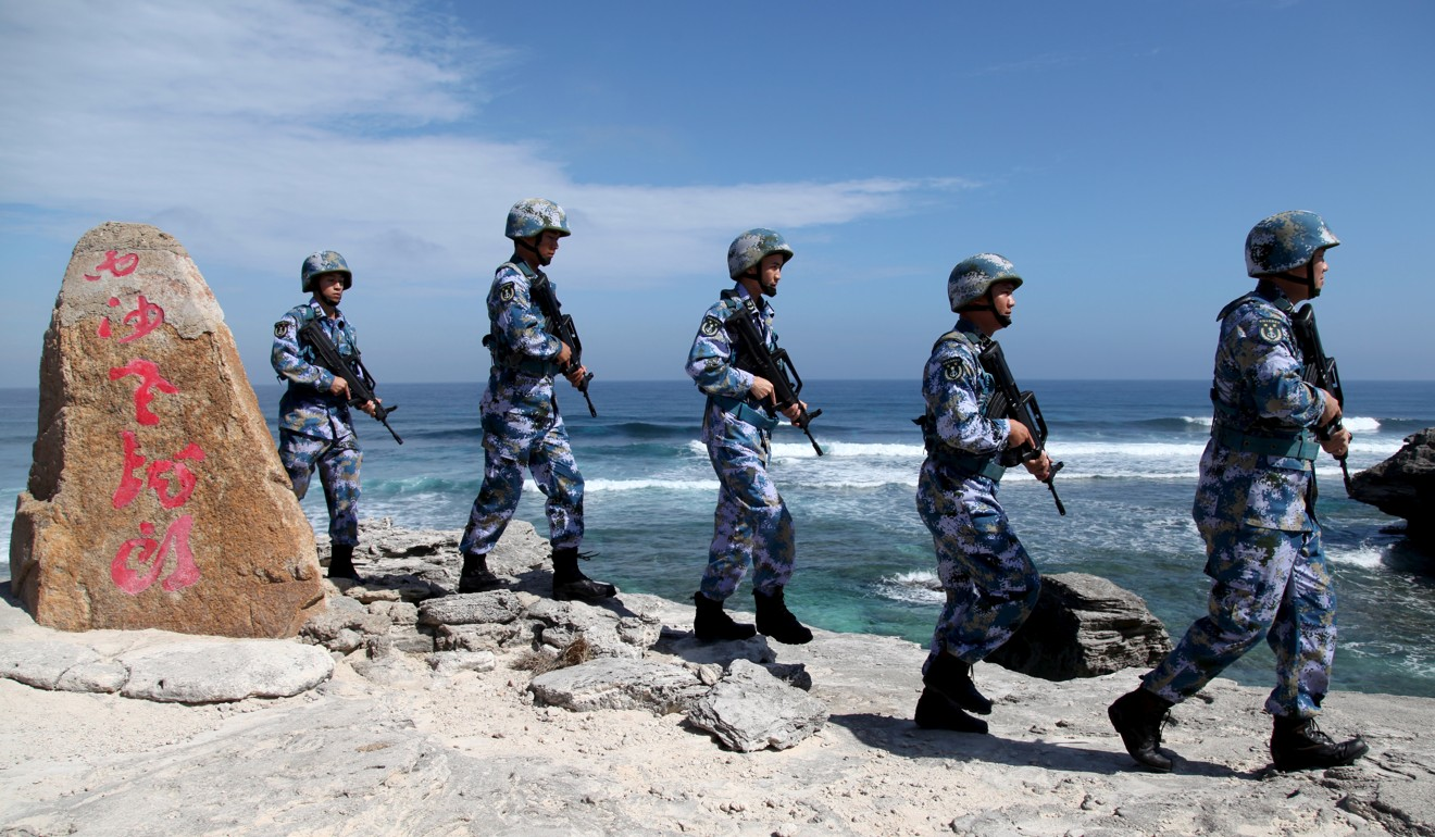 A patrol by the People's Liberation Army on Woody Island, in the Paracel Archipelago. Photo: Reuters