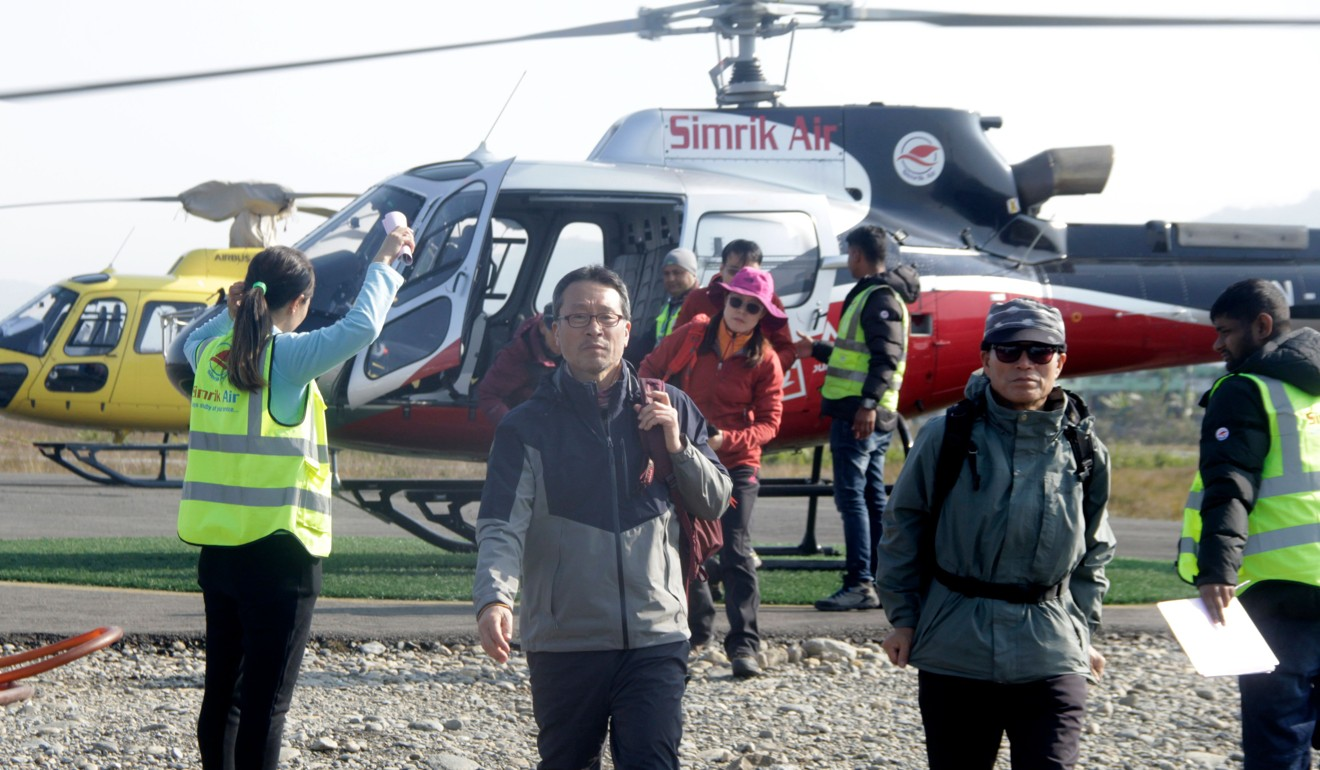 Nepal avalanche: bad weather means search for South Korean hikers could take weeks