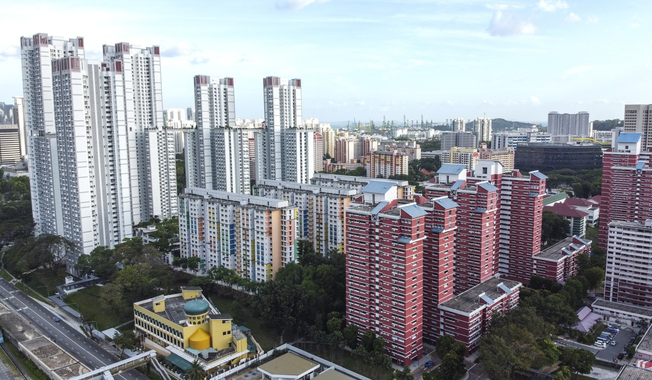 Public housing in Singapore. A third of Singapore's energy consumption goes towards cooling residential and commercial properties. Photo: Roy Issa