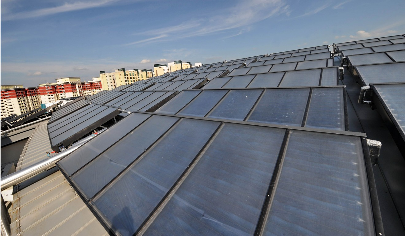 Solar panels on the roof top of the United World College Southeast Asia in Singapore. The country is building up its solar power coverage and by the end of the year will have panels on half of its public housing flats. Photo: AFP