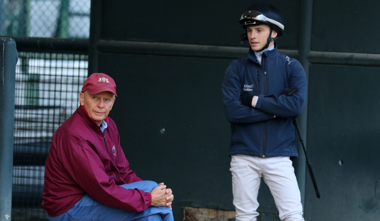 Trainer John Moore and jockey Lyle Hewitson at trackwork earlier this month.