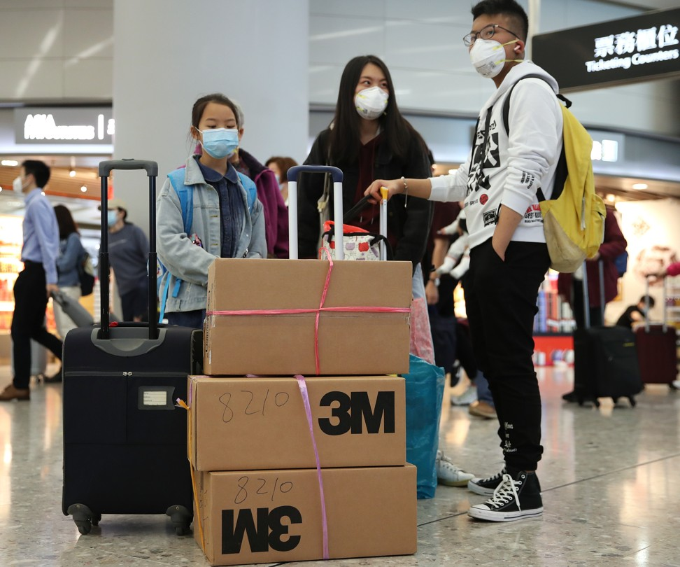Travellers at the High Speed Rail Station in West Kowloon take precautions against the Wuhan coronavirus. Photo: Winson Wong