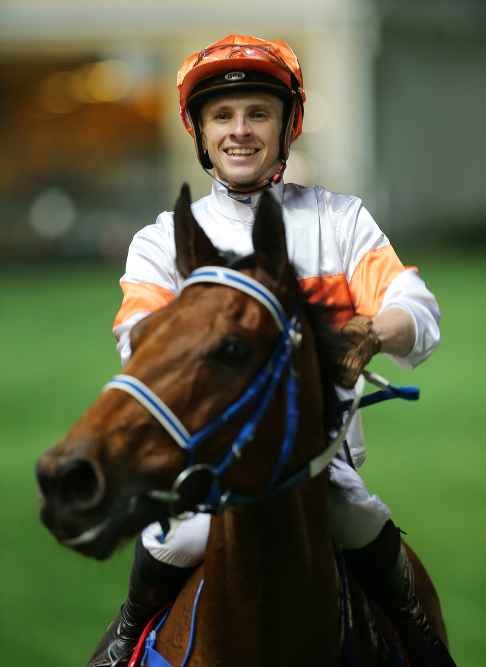 Lyle Hewitson is all smiles as he returns to scale after winning with Kiram.