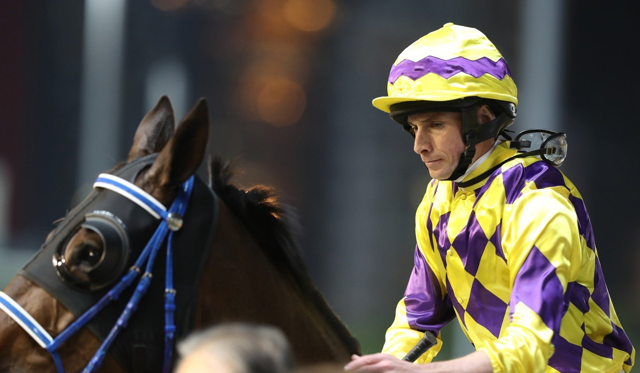 Ryan Moore rides a winner at Happy Valley in the International Jockeys' Championship in December.