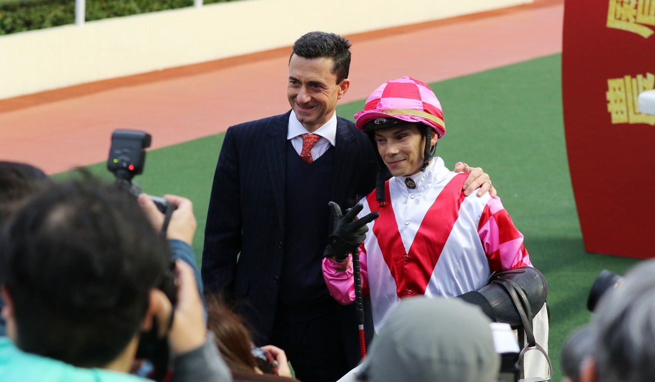 Douglas Whyte with jockey Alexis Badel after winning with Super Wealthy at Sha Tin.