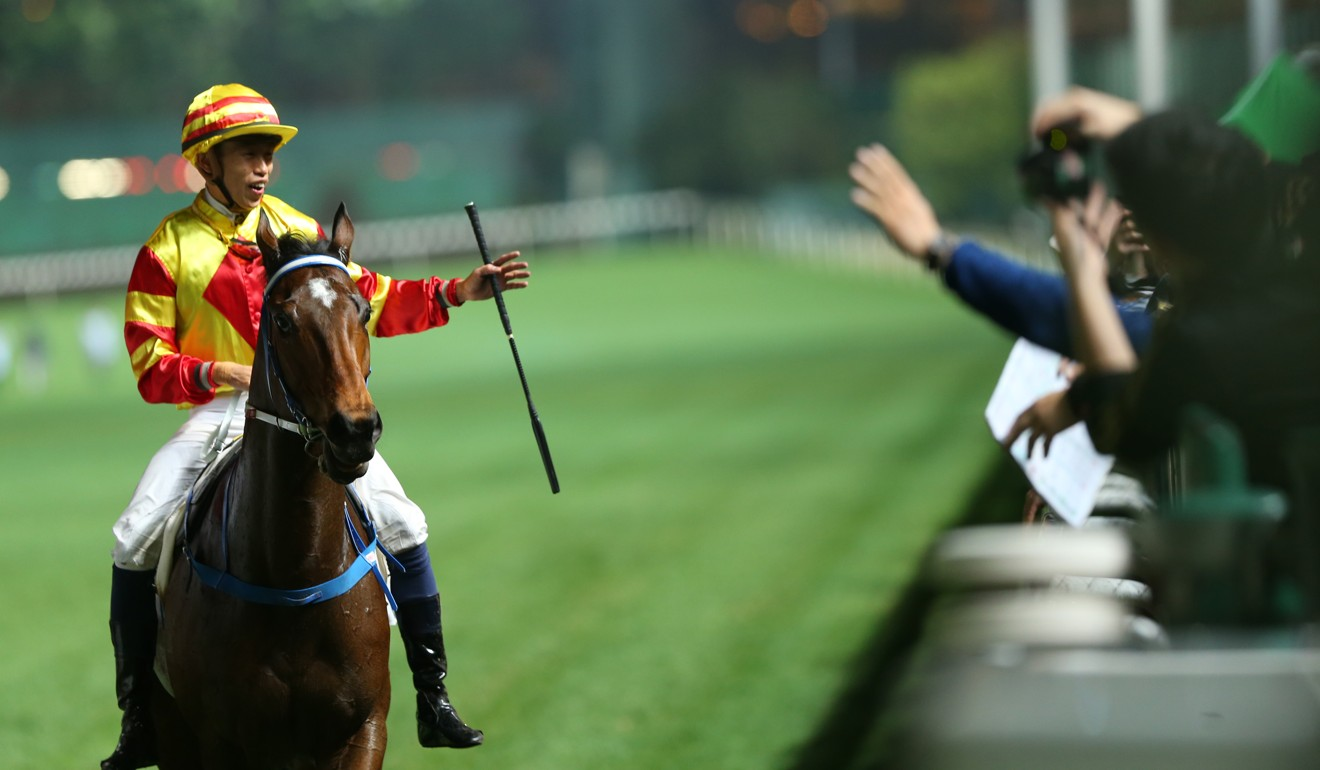 Vincent Ho salutes to the crowd after riding a winner at Happy Valley.